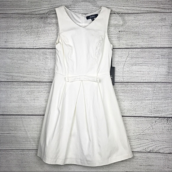 Lulu's Dresses & Skirts - Lulu's Hot off the Press Ivory Bow Dress
